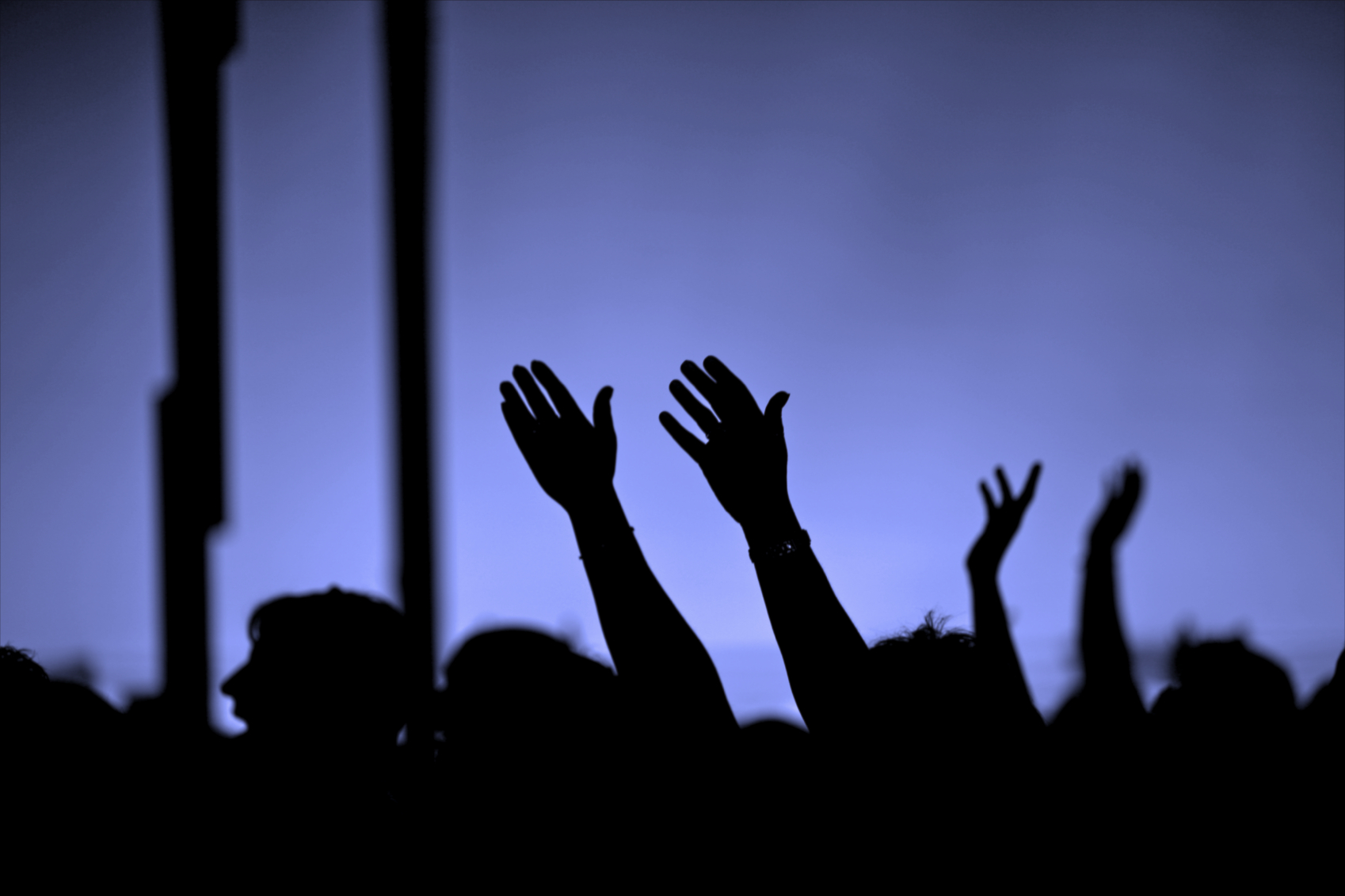 Crowd with hands reaching up