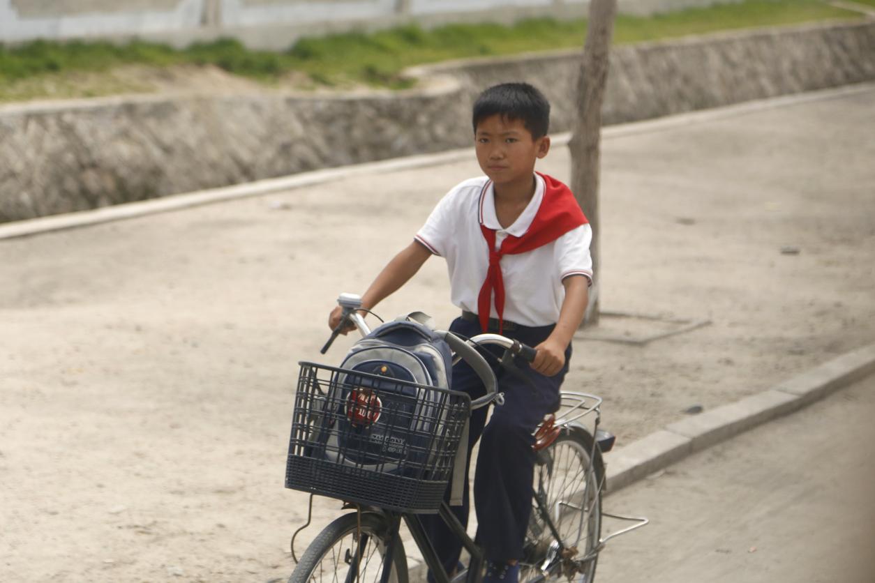 North Korean boy on bike