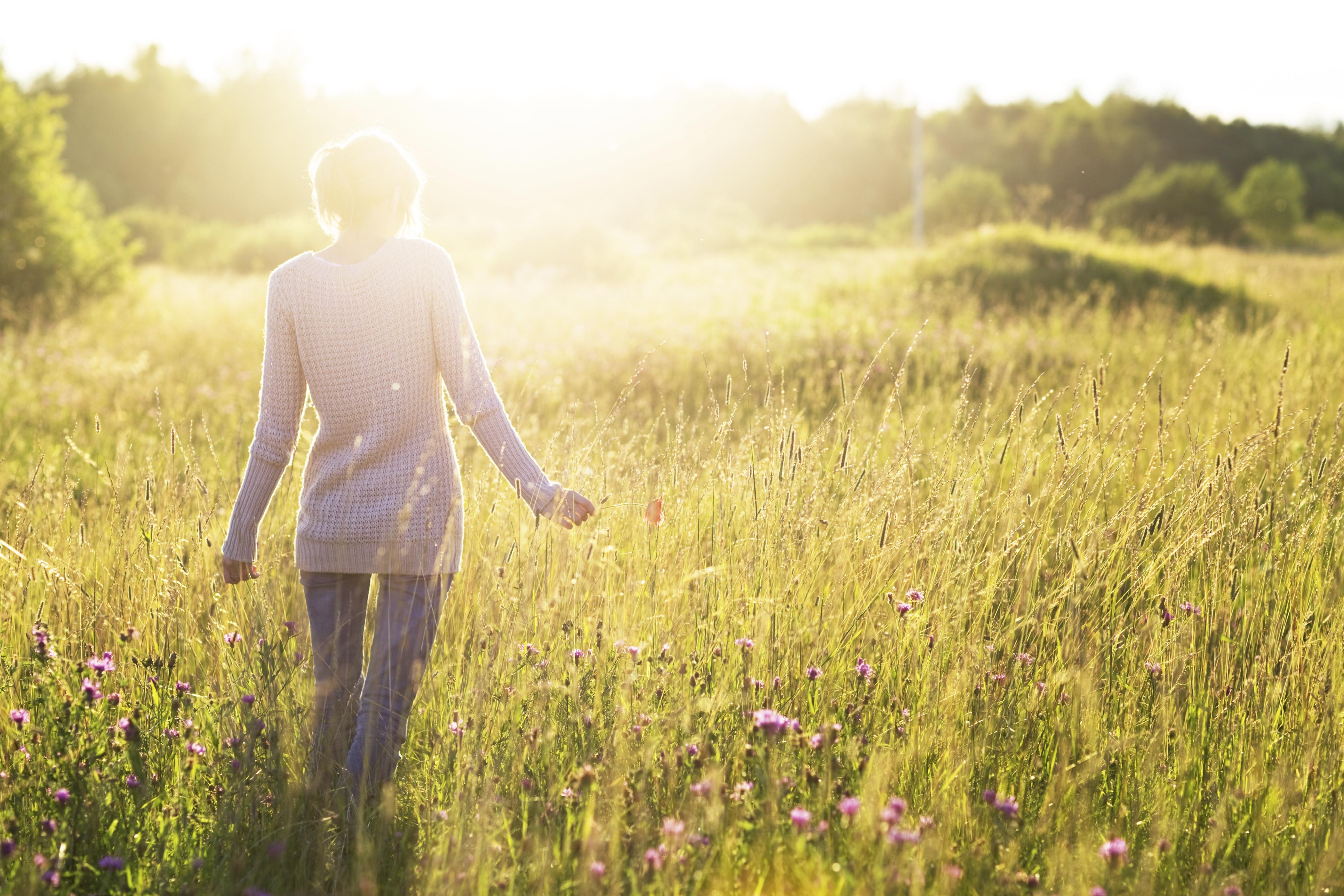 woman walking in sunshine